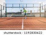 sportsman playing padel game | Shutterstock . vector #1192830622