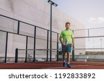 sportsman playing padel game | Shutterstock . vector #1192833892