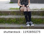 young girl with net tights is... | Shutterstock . vector #1192850275