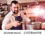 a handsome  bearded barista man ... | Shutterstock . vector #1192866958
