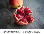 red juice pomegranate on dark... | Shutterstock . vector #1192934602