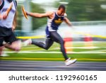 blurred track and field runner... | Shutterstock . vector #1192960165