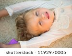 girl with blue eyes on adorable ... | Shutterstock . vector #1192970005