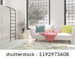 white room with sofa and winter ... | Shutterstock . vector #1192973608