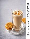 caramel coffee latte in a tall... | Shutterstock . vector #1192991938