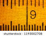 number nine on a wooden ruler   ... | Shutterstock . vector #1193002708