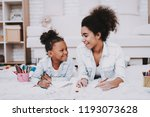 parent with little girl draw...   Shutterstock . vector #1193073628
