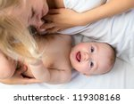 happy mother lying with baby boy | Shutterstock . vector #119308168