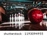 Small photo of bowling ball and pins