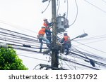 electricity workers are... | Shutterstock . vector #1193107792