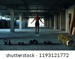 fitness  a young man in the gym | Shutterstock . vector #1193121772