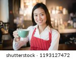 asian woman barista smiling... | Shutterstock . vector #1193127472