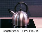 metal kettle on modern kitchen     Shutterstock . vector #1193146045