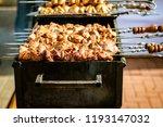 shish kebab on skewers is fried ...   Shutterstock . vector #1193147032