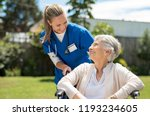 nurse taking care of old woman... | Shutterstock . vector #1193234605