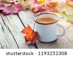 enameled cup of coffee and... | Shutterstock . vector #1193252308