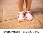 baby girl learning to put on... | Shutterstock . vector #1193273542