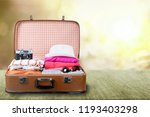 suitcase with clothes and other ... | Shutterstock . vector #1193403298