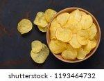Crispy Potato Chips In Bowl On...