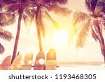 surfboard and palm tree on... | Shutterstock . vector #1193468305