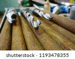 the drills lie on a rack near... | Shutterstock . vector #1193478355