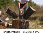 Lumberjack Chopping Wood For...