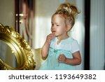 kid model make up at mirror in...   Shutterstock . vector #1193649382
