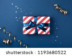 gift box wrapped in red striped ... | Shutterstock . vector #1193680522