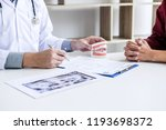 male doctor or dentist writing... | Shutterstock . vector #1193698372