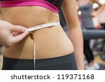 Measuring Womans Waist In The...
