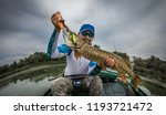 fishing. fisherman and trophy... | Shutterstock . vector #1193721472