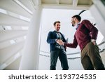 cropped shot of two colleagues... | Shutterstock . vector #1193724535