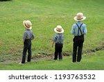 Amish Boys By A Stream ...