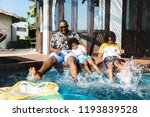 family playing in a pool | Shutterstock . vector #1193839528