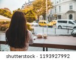 woman sitting in cafe with big... | Shutterstock . vector #1193927992