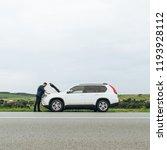 man stand near broken car with...   Shutterstock . vector #1193928112