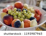 fruit on a white plate  peaches ... | Shutterstock . vector #1193987965