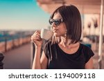 beautiful young female drinking ... | Shutterstock . vector #1194009118