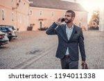 young handsome businessman... | Shutterstock . vector #1194011338
