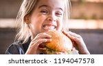little cute girl eating a... | Shutterstock . vector #1194047578