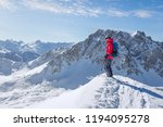 male ski tourer enjoying the... | Shutterstock . vector #1194095278