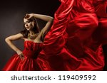 Woman In Red Dress Dancing Wit...