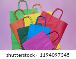 group of colorful shopping bags ... | Shutterstock . vector #1194097345