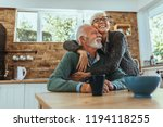 mature woman hugging her husband | Shutterstock . vector #1194118255