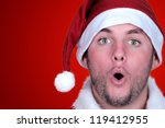 Small photo of young man dressed as Santa Claus saying oh oh oh!!