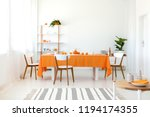 long dining room table covered... | Shutterstock . vector #1194174355
