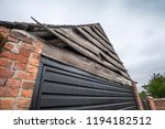 garage with rustic warped... | Shutterstock . vector #1194182512