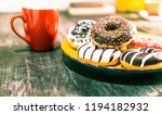 assorted donuts and red coffee... | Shutterstock . vector #1194182932