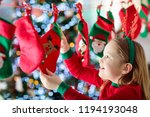 kids opening christmas presents.... | Shutterstock . vector #1194193048