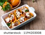stuffed bell peppers with... | Shutterstock . vector #1194203008